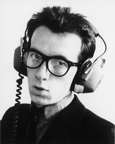 Elvis Costello. °