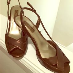 """Brown """"Connie"""" Sandals Brown sandals with strapped heals and crosses at the toe. Gently used. No longer need. Connie Shoes Sandals"""