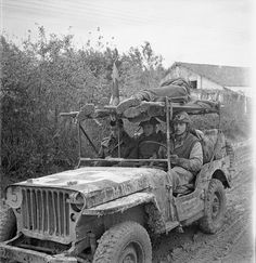 A jeep ambulance of the Royal Canadian Army Medical Corps (R.C.A.M.C.) bringing in two wounded Canadian soldiers on the Moro River front south of San Leonardo di Ortona, Italy, 10 December 1943.