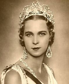 Queen Maria José of Italy wearing the Musy Tiara with jewel conventionally positioned more towards the back of the crown or in the style of the '30s and '40s