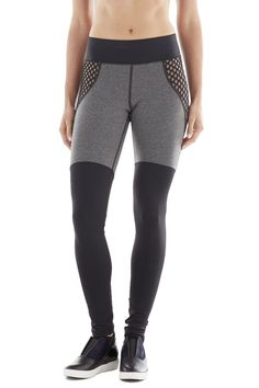 I like the light colored (or sheer?) fishnet inserts. They bring the eye up and less to the awkward cut-off thigh pieceings.
