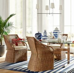 Rattan Chairs for a Coastal Vibe.... http://www.completely-coastal.com/2017/04/indoor-rattan-chairs-for-coastal-beach-decor.html Rattan chairs in all kinds of styles, as dining room chairs, side chairs for your living room, bedroom, entryway.