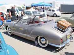 1959 Karmann Ghia Convertable! Pre 1960 Ghias are also called drop nose because of the raised headlights on 1960 models and up.They just kinda ran the front fenders straight out!