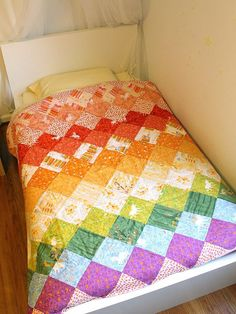 Rainbow Quilt by Rae by madebyrae, via Flickr.  I love this!