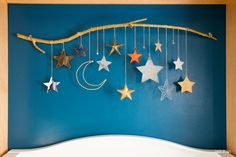 DIY Baby Mobile with Stars and Moon by Make your own DIY baby mobile using star ornaments, chain, and a tree branch. Perfect for a baby girl or baby boy nursery. - DIY Baby Mobile with Stars and Moon Ramadan Crafts, Ramadan Decorations, Crafts To Make, Crafts For Kids, Diy Crafts, Baby Band, Decoraciones Ramadan, Baby Car Mirror, Baby Mobile