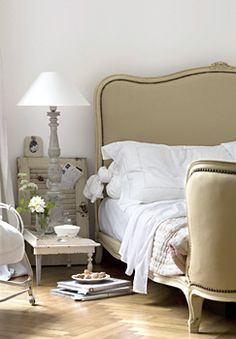 Gorgeous Antique Bed & beautiful white linens & Love the herringbone wood flooring!