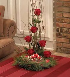 church floral arrangement ideas | Incorporate lots of candles into your Christmas Wedding Theme. This ...