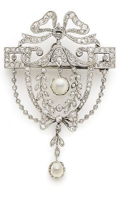 *A belle époque half pearl and diamond brooch/pendant, circa 1905 The openwork cartouche of garland design, millegrain-set with cushion-shaped diamonds, and suspending two half-pearl drops, diamonds approx. 1.50cts total, length 5.0cm