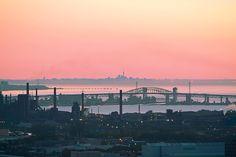 Burlington Skyway Bridge Sunrise, taken from Hamilton Mountain with Toronto Skyline in the distance, Lake Ontario, Canada   by Michael Muntz, via 500px