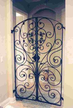 - Italian styled wrought-iron gate with custom latch Wrought Iron Gate Designs, Wrought Iron Fences, Wrought Iron Doors, Iron Fence Gate, Metal Gates, Fence Gates, Tor Design, Iron Furniture, Iron Work