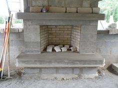 Outdoor fireplace. Masonry by Village Craft Iron & Stone, Inc.
