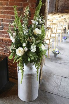 milk churn flowers -...