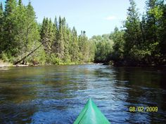 The Beautiful Au Sable River ~ Grayling Michigan.  This looks like it is right in front of Dave's cabin.