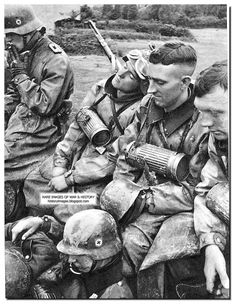 """Motorcyclists SS Division """"Totenkopf"""" take a breather in camp"""