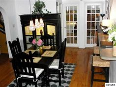 Located between the kitchen to the left and the living room to the right, this large dining room is perfect for entertaining.