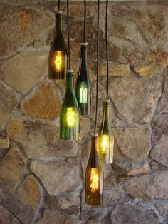 Give a spin to your old wine bottles for transforming them into tasteful decorative pieces. Check out the wine bottle crafts collection here for novel ideas. Old Wine Bottles, Lighted Wine Bottles, Glass Bottles, Diy Bottle, Wine Bottle Crafts, Bottle Art, Wine Bottle Chandelier, Wine Bottle Lighting, Liquor Bottle Lights