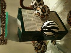 Painted animal print on old Christmas decorations