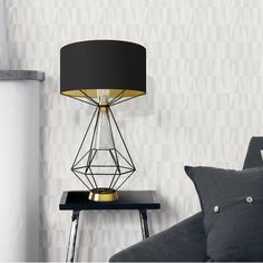 Nola Table Lamp -Representing Southern Artists who work in glass, ceramics, metals and wood, Nola table lamp combines a double colour fabric shade supported by a black lacquered wire brass structure. Illuminated by a clear blown glass shade, this contemporary look is enhanced with elegant accents of polished #gold brass at the base and glass shade ring.