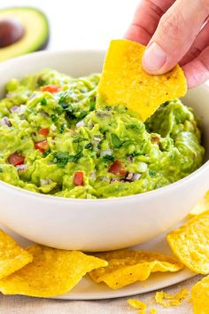 Guacamole is easy to make, tasty, and each scoop is packed with nutrients. The recipe is a simple combination of mashed avocado, lime juice, jalapeno, tomato, onion, cilantro, garlic, and salt, that's it! #guacamole #avocado #tortillachips