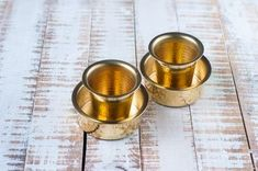 The taste of sipping the morning coffee from the traditional davara tumbler is enough send most down the memory lane. Zishta Brass coffee davara tumbler is handmade with the highest quality brass, by the artisans of Maharashtra. Buy Clay, One Time Password, Cast Iron Cookware, Copper And Brass, Coffee Set, Moscow Mule Mugs, Cool Things To Make, Utensils, It Cast
