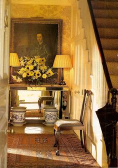 English Country Manor foyer and stairs - love the mirror under the table