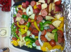 Sausage and more sausage.... Just cut up potatoes I used (red potatoes), green and yellow bell peppers, onion and 4 links of sausage (just pick your favorite sausage I used polish links). Drizzle olive oil and salt and pepper and garlic powder then mix well place in the oven at 400 for 35 mins. Make sure to use a deep pan! Yummy!!!