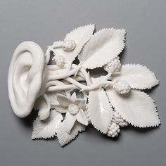 "Taking Root, 4 ½""x4""x½"", hand built porcelain, cone 6 glaze, 3/2009  Kate MacDowell"
