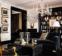 Too snobbish looking.. but a good picture of dark floors and white walls with dark wood and furniture.