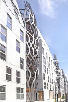 Tetrarc Architects have designed an apartment building in Paris, France, that has a number of sculptural features, adding visual interest to an otherwise plain building.