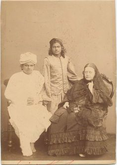 [Madame Blavatsky with two Indian (?) men.]