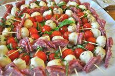 {2} Appetizer Part One: Caprese Skewers salami , mozzarella, cherry tomato, basil, balsamic vinagarette, EVOO