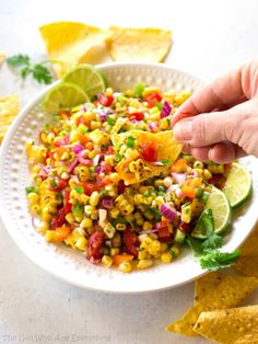 This Corn Salsa is a fresh corn salad with tomatoes, onion, bell peppers, jalapeno, and cilantro. Add a squeeze of lime and you're done!Imagine the Corn Salsa from Chipotle with a scoop of Pico de Gallo all mixed together. That's what this Corn Salsa tastes like.This Corn Salsa can be served as an appetizer with chips or as a salsa over a salad, fish, or chicken. the-girl-who-ate-everything.com