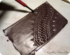 Cynthia Gordillo: Tutorial about making texture plates. It may be in Spanish, but it is a wonderful tutorial.