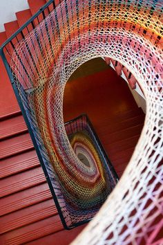 I'd love to have this staircase, nevermind the beautiful fiber weaving!!!