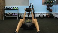 Need more of a challenge for your sit-ups? Try doing a weighted sit-up by holding a sandbag overhead.