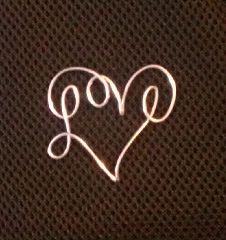Random Wire Art: October 2011 I really like this.  (In 1979 I bought my name at our Fair.  It had a small heart hanging.  JML)