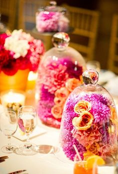 Bell Jars make amazing centrepieces and you can use anything you like inside them from flowers to candles to ornaments
