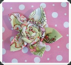 Crafting and Creativity: fabric flowers- sewn by hand///love the twisted flower in center