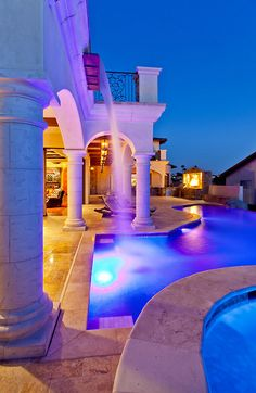 Yes! Love this! Huge arches (I want them raised) with entertainment area under it.. I want my pool lower with steps on the side leading down to the pool