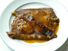 Crêpes Suzette: Crêpes Suzette are pancakes filled with orange-flavoured butter (butter and sugar mixed with Grand Marnier), caramelized in a pan and soaked in orange-flavoured syrup. This is an modified version of the recipe invented by Auguste Escoffier.