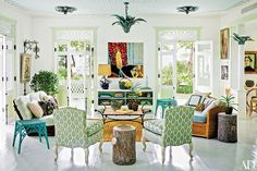 The slipper chairs in the living room of Celerie Kemble's Dominican Republic retreat are from the designer's line for Henredon | White, blues, greens, rattan.