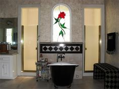 The master baths simple elegance is centered around a reproduction of a cast iron vintage claw foot tub