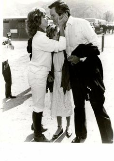 Don't know when or where this was taken (sometime in the early- to mid-80's, I'd say), but it's a very tender moment between Robert Wagner and Stefanie Powers (between them is Natasha, one of his 3 young daughters at the time).