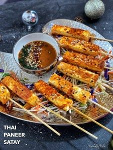 Thai Paneer Satay , infused with dynamic flavors is an excellent recreation of the traditional Indian kebab. Marinated in coconut milk , lemongrass and Thai curry paste, and grilled on fire, these kebabs are just waiting to be eaten! Kebab Recipes, Veg Recipes, Curry Recipes, Indian Food Recipes, Vegetarian Recipes, Cooking Recipes, Indian Snacks, Recipies, Thai Appetizer