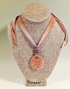 Copper Lace Sunset Ceramic Necklace - By Lilah Flores Creations: This handmade copper lace stoneware creation was inspired by the colors that can be seen during a sunset in the desert. This reduction fired ceramic lace necklace would make a lovely addition to your jewelry collection or a fantastic gift for friends, family members, bridesmaids, coworkers, and more!