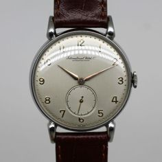 Vintage Watches Collection : IWC - Vintage - Men - 1948 - Watches Topia - Watches: Best Lists, Trends & the Latest Styles Diesel Watches For Men, Vintage Watches For Men, Luxury Watches For Men, Simple Watches, Cool Watches, Timex Watches, Amazing Watches, Leather Watch Bands, Steve Mcqueen