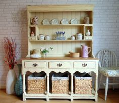 Absolutely Gorgeous Antique Dresser/Buffet/Server Transformed with Annie Sloan's Cream & Some Beautiful Wicker Baskets. Shabby Chic!                   I can see this transformed into the kitchen area in a tiny house. It would hold the sink, 2 or 3 burner unit as well as kitchenware...love the idea!