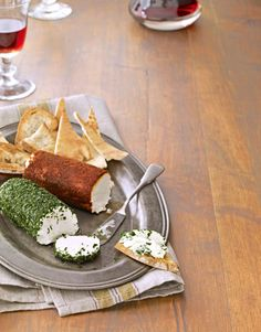 Our fresh take on the cheese ball comes with an added bonus: The log shape allows guests to slice, rather than dig, into the appetizer.  Recipe: Goat Cheese Logs   - CountryLiving.com