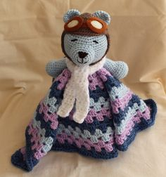 Teddy Bear Security Blanket . I used a free pattern by The Stitchin Mommy to make the granny square, the bear is my own creation.