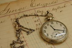 Original account books for the antique store and the pocket watch found in the locked safe.
